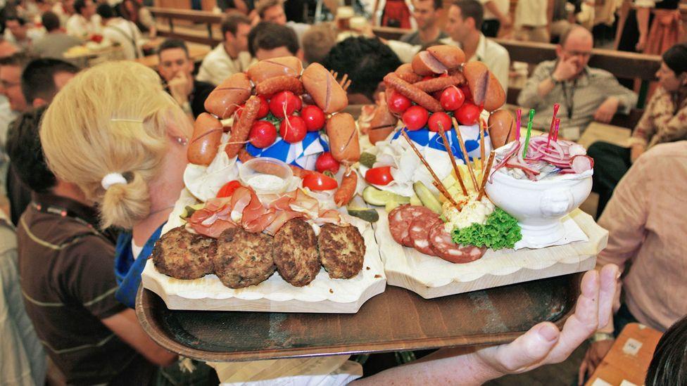 Sausages are always on the menu at German beer halls, or Biergartens (Credit: Pat Behnke/Alamy)