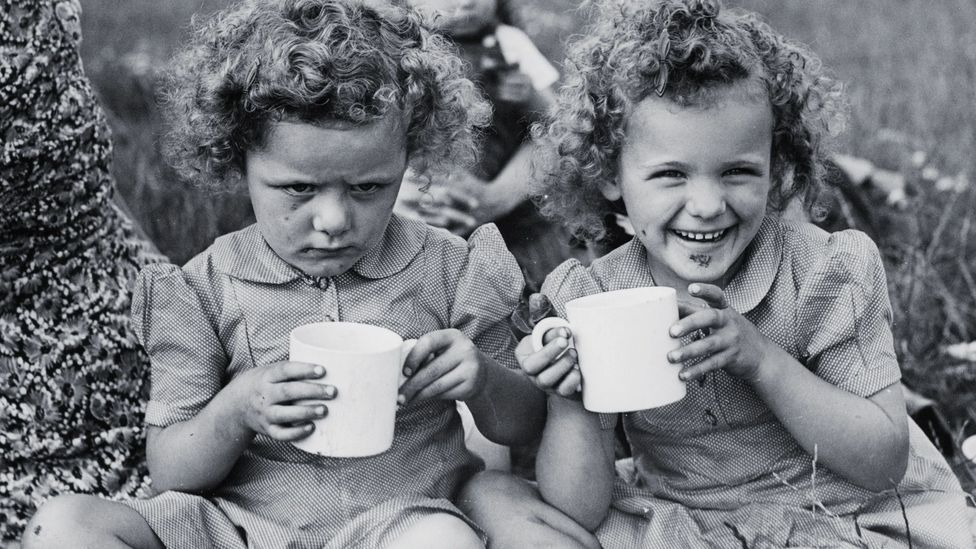 Happy and sad twins (Credit: Alamy)