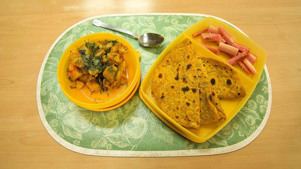 Carrot salad, masala roti and suka bhaji potatoes (Credit: Mayank Soni)