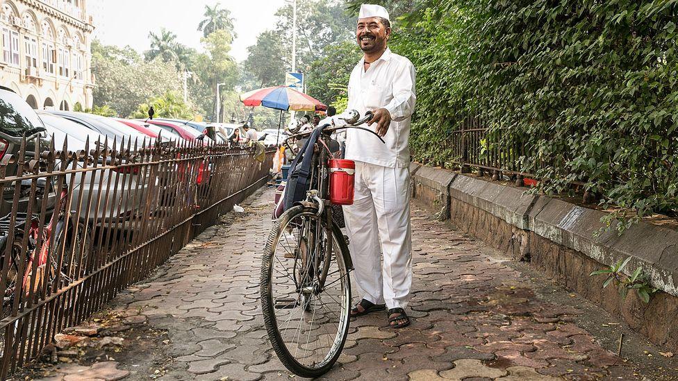 A dabbawala delivers carrot salad, masala roti and suka bhaji potatoes (Credit: Mayank Soni)