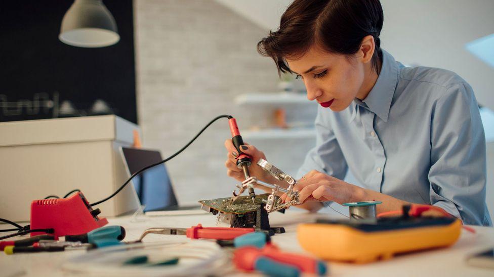 Woman working on circuit board