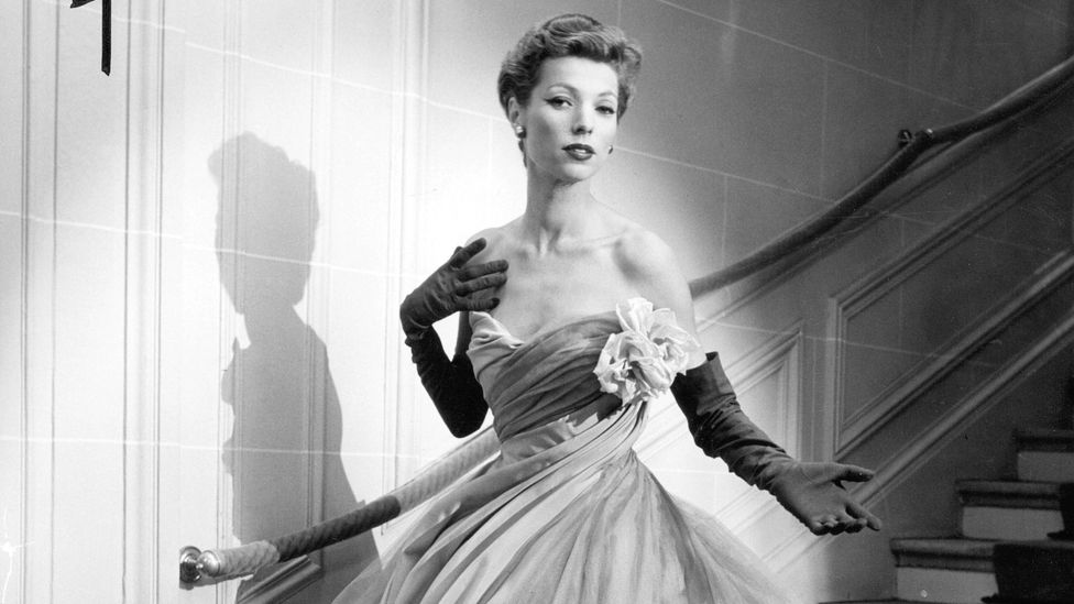 Christian Dior dramatically broke away from convention with his 'New Look', which emphasised a nipped-in waist and prominent bust (Credit: Alamy)