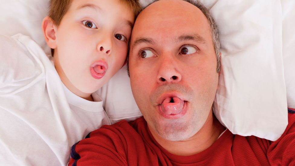 Father and son rolling tongues (Credit: Alamy)