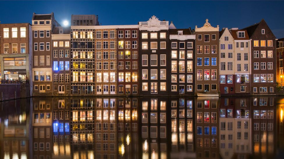 Many of the older houses in the Netherlands have big windows, allowing passers-by to look inside (Credit: Inigo Cia/Getty Images)
