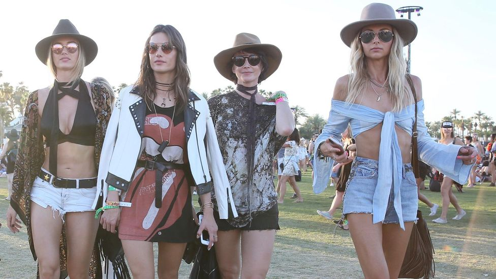 Festival-goers today still like to wear their musical tastes on their T-shirts (Credit: Alamy)