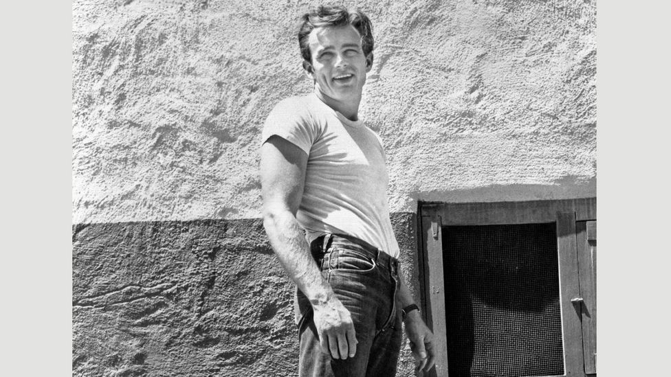 As heart-throbs like James Dean appeared in films during the 1950s wearing a T-shirt, it became a symbol for youthful rebellion (Credit: Alamy)