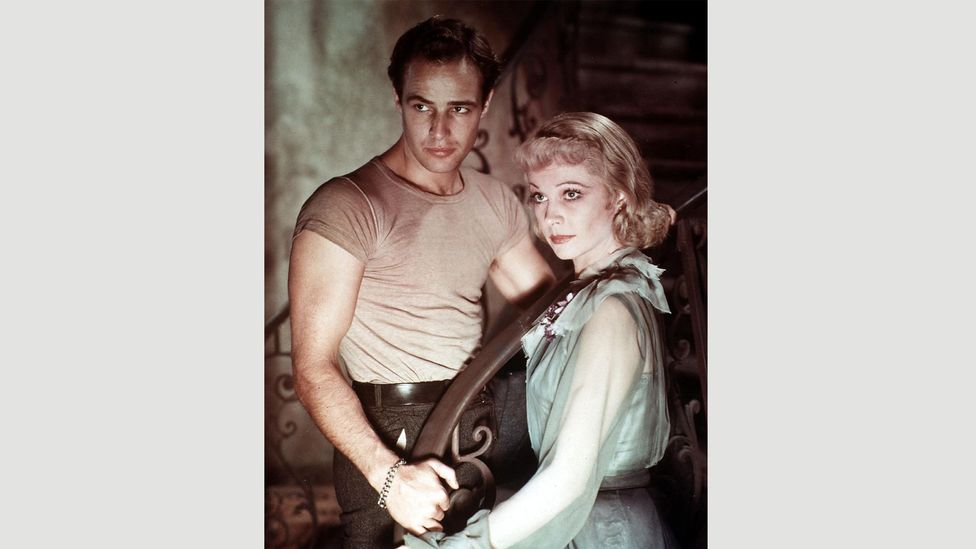 Marlon Brando helped to popularise the T-shirt when he wore one in the 1951 film A Streetcar Named Desire (Credit: Alamy)