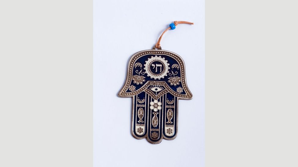 The Hamsa is an amulet in the shape of a palm with an eye in the middle embraced by Jews, Christians and Muslims in North Africa and the Middle East (Credit: Alamy)