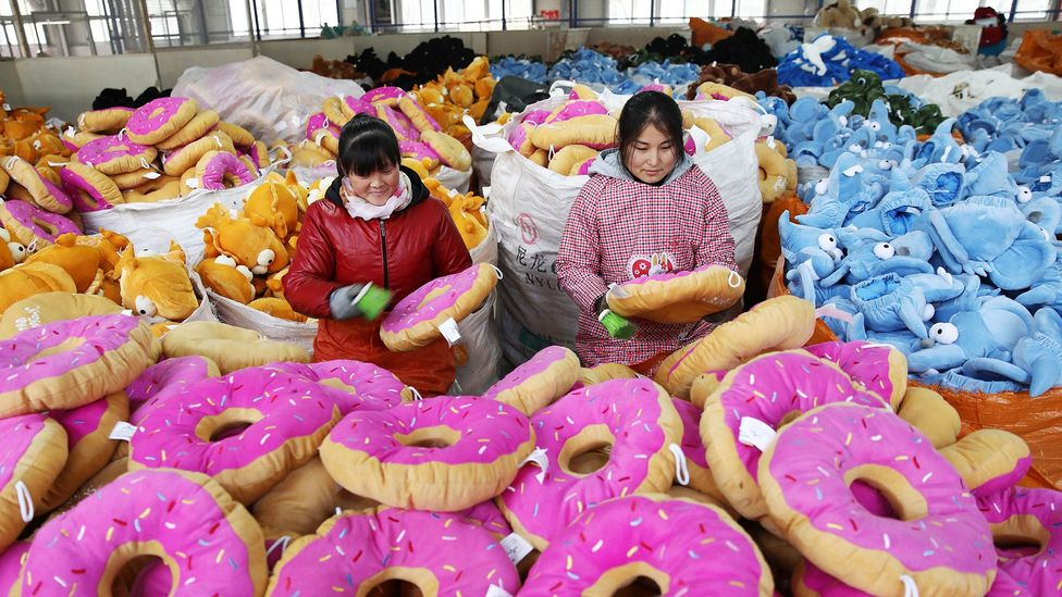 This January 2018 photos shows Chinese employees creating toys at a factory in China's eastern Jiangsu province (Credit: Getty Images)