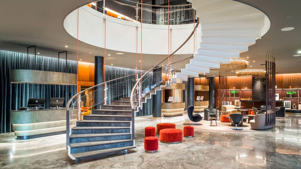 The original, elegant staircase in the lobby is the hotel's most spectacular and glamorous feature (Credit: Joachim Wichmann)