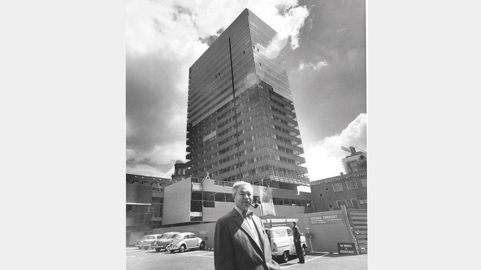Modernist design master Arne Jacobsen stands outside his landmark creation, the Royal Hotel, Copenhagen (Credit: Radisson Blu Royal Hotel)