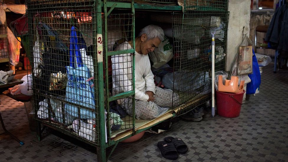 For nearly a decade, many in Hong Kong have struggled to keep up with soaring housing prices, forcing many to live in cages (Credit: Getty Images)