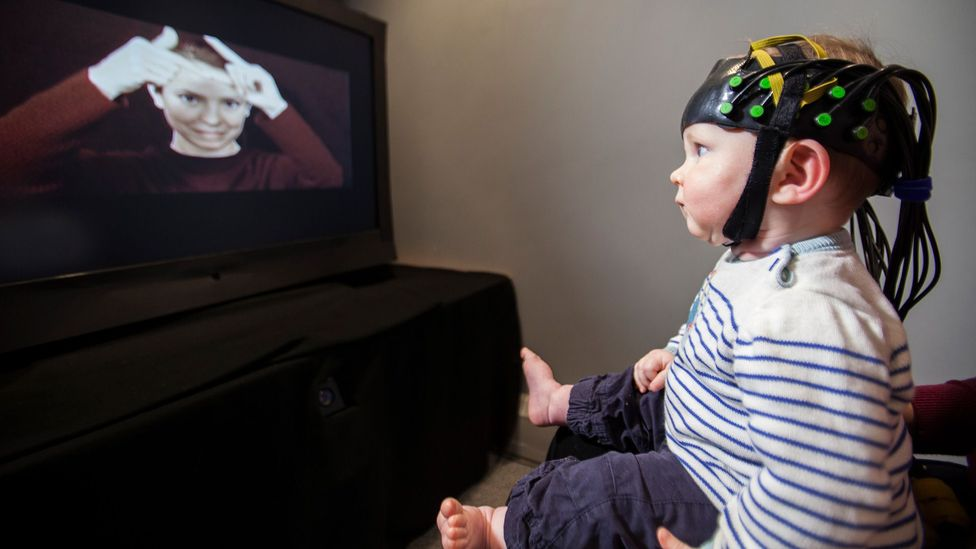 This futuristic-looking cap allows scientists to peer into babies' brains to see how they process encounters with others