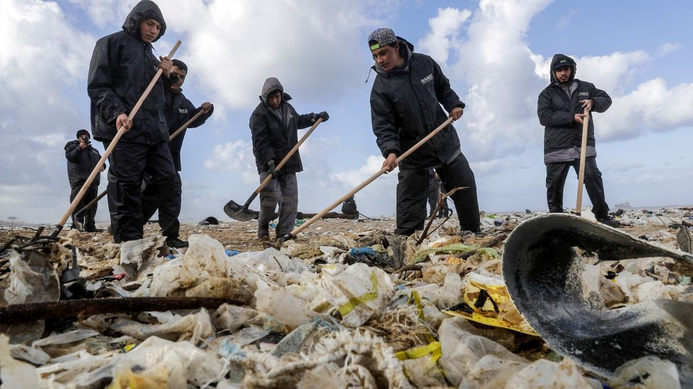 People cleaning beach (Credit: Getty Images)