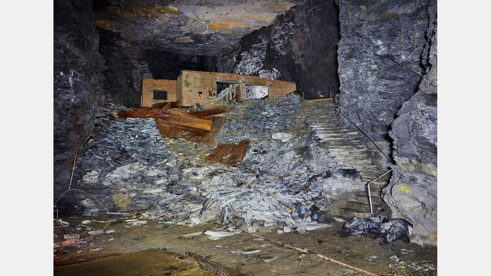 Some of the underground structures built in the slate mine at Manod are still standing today – and discarded art storage materials can be found (Credit: Robin Friend)