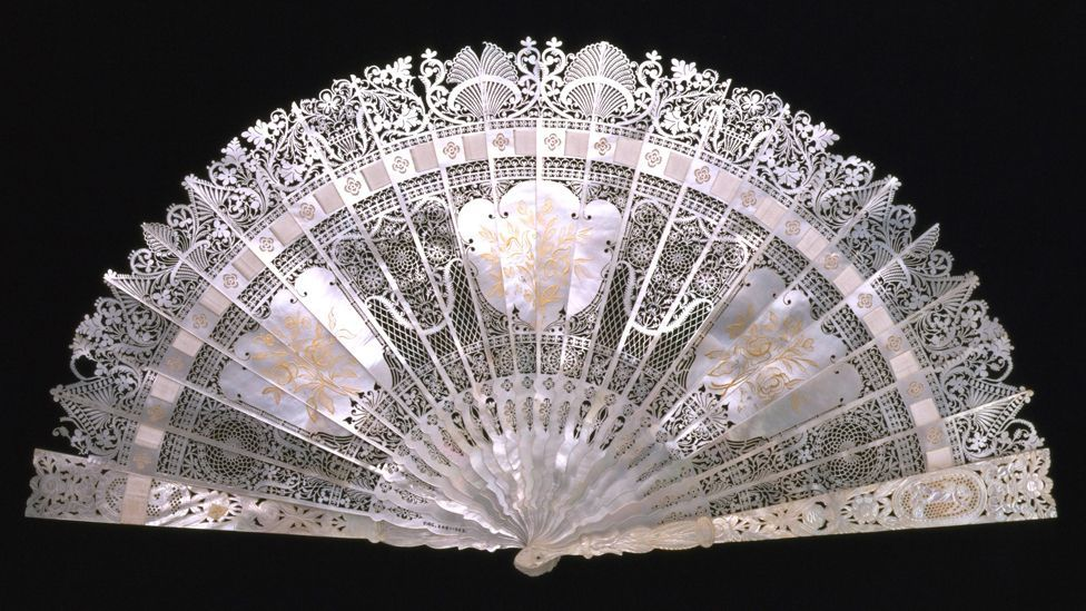 A delicately carved mother-of-pearl fan made in France in the 1800s is among the show's exhibits (Credit: Victoria and Albert Museum, London)