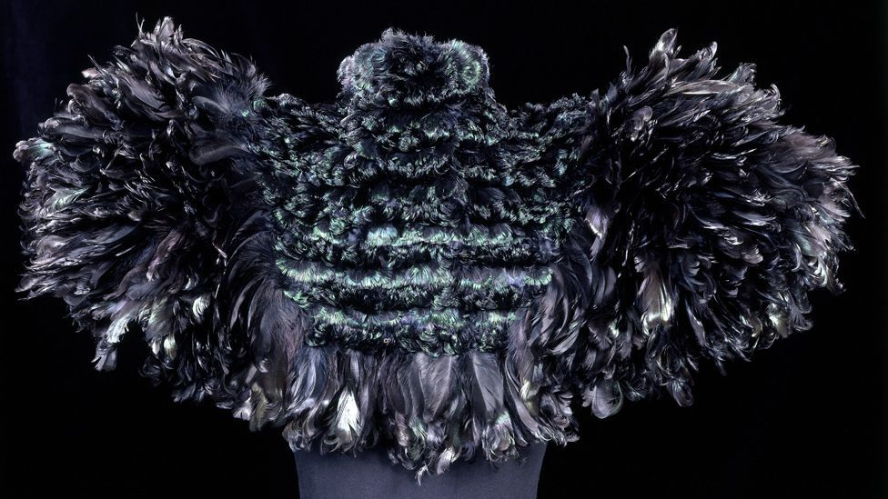 A cape of curled cockerel feathers created by Auguste Champot in 1895 (Credit: Victoria and Albert Museum, London)