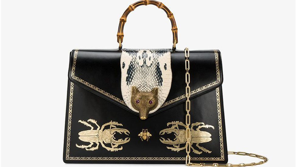 Designer brands continue to be drawn to flora and fauna, as seen in this recent handbag by Gucci, featuring fox-head and beetle motifs