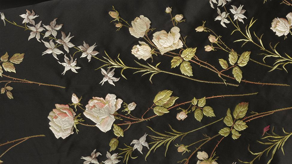 A detail of a 1890s silk train, meticulously woven with a pattern of roses (Credit: Victoria and Albert Museum, London)