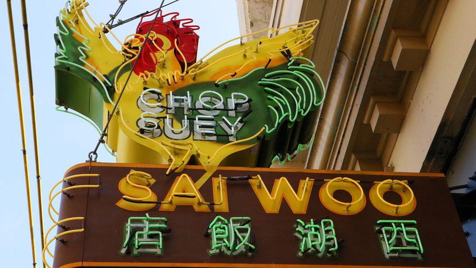 Owner Salli Pateman raised nearly C$20,000 to locate and restore the Sai Woo restaurant's original neon sign (Credit: Mike MacEacheran)