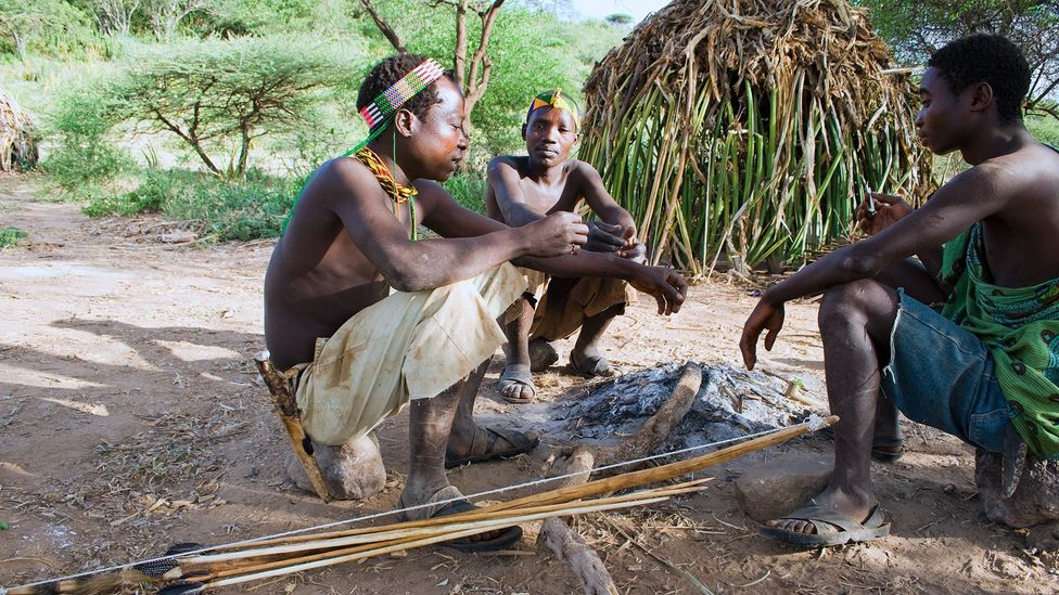 Members of Tanzania's Hadza tribe, who wake and sleep more in tune with natural day and night, experience few sleep problems (Credit: Getty Images)
