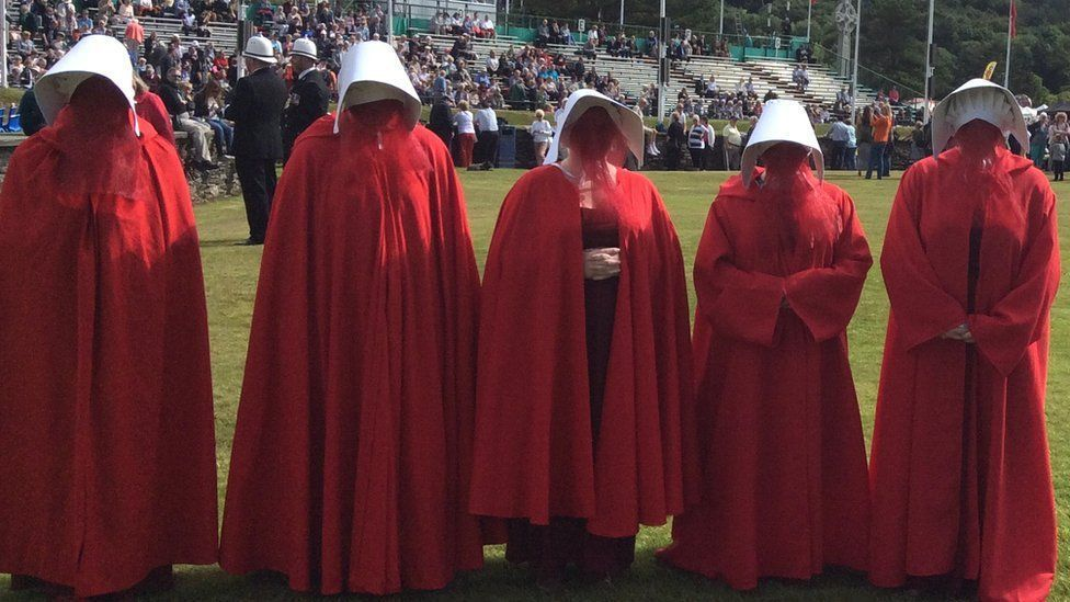 Manx protestors donned Handmaid's Tale inspired outfits in July 2017 to protest women's lack of access to abortion providers in the Isle of Man (Credit: BBC News)