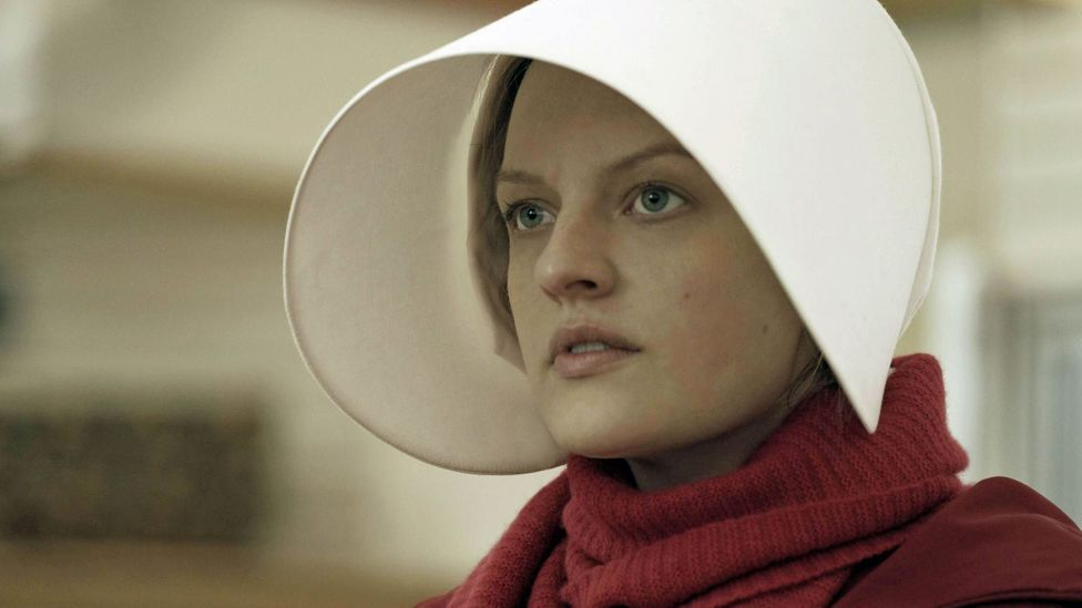Elisabeth Moss plays Offred, the main character in Atwood's story – the TV series now goes beyond the events of the novel, with its writers inventing new material (Credit: Hulu)