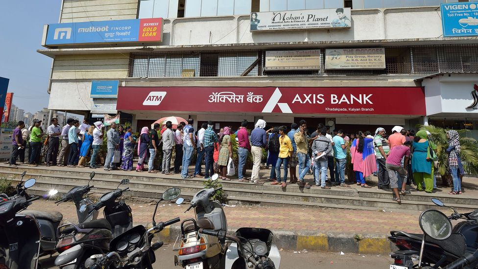 Some denominations of Indian bank notes were discontinued in 2016 leading to long queues of people waiting to withdraw money (Credit: Getty Images)