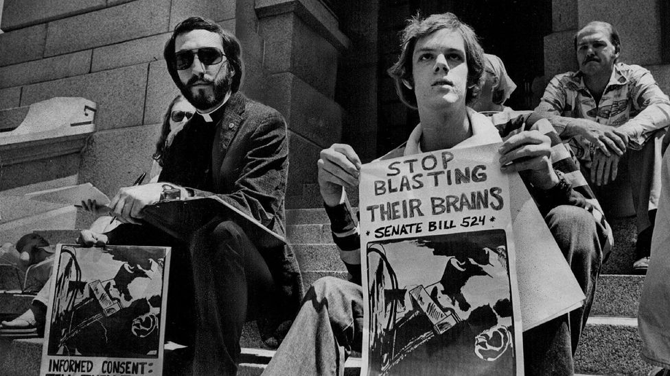 Demonstrators rally in favour of a 1977 bill to warn patients of ECT's risks (Credit: Getty Images)
