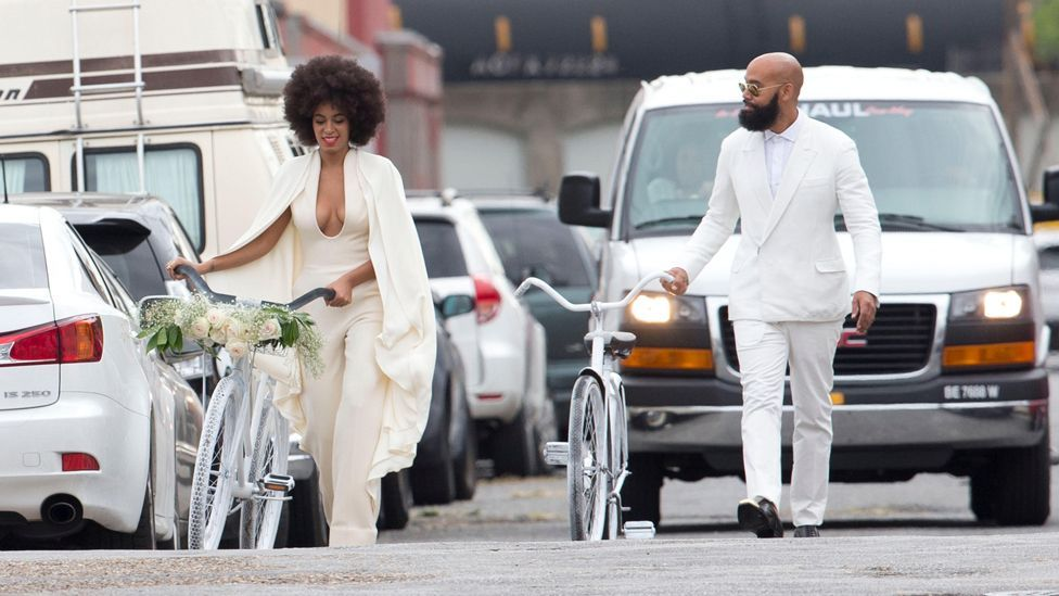 Solange Knowles wore a backless white jumpsuit when she married Alan Ferguson in 2014, and the couple arrived at their wedding on bicycles (Alamy)