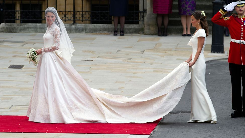 The Duchess of Cambridge wore a lace wedding dress by designer Sarah Burton for McQueen (Credit: Alamy)