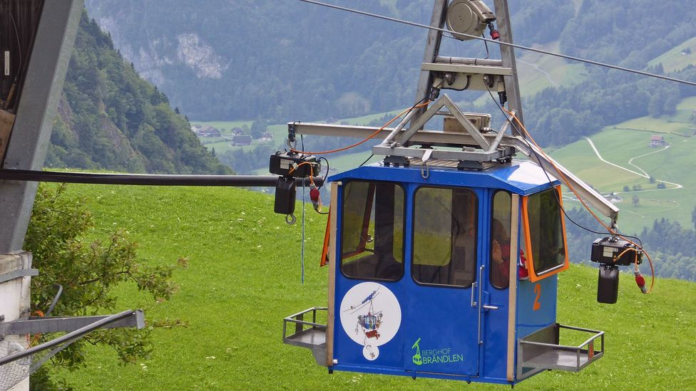 Farmer Ueli Schmitter admits to being obsessed with his blue-and-green cable cars, and helps his neighbours keep theirs in good working order (Credit: Larry Bleiberg)