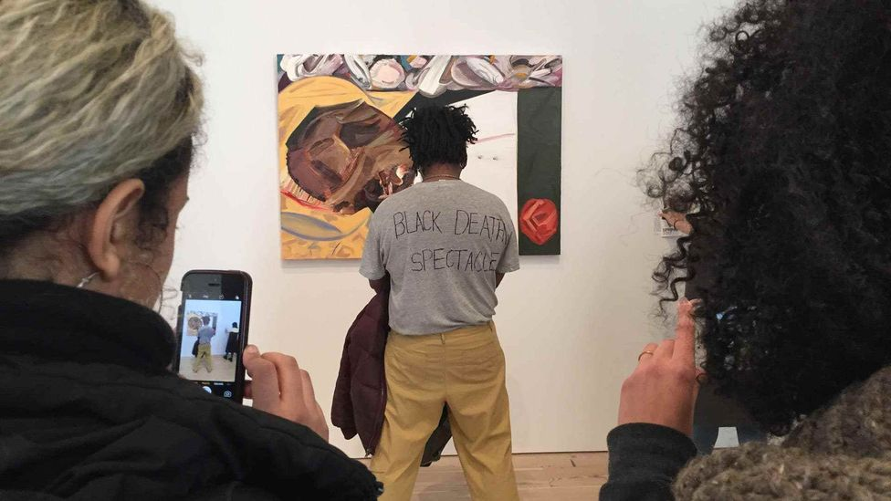 Artist Parker Bright protested Dana Schutz's stylised take on US lynching victim Emmett Till by obstructing view of it (Credit: Twitter/User does not wish to be identified)