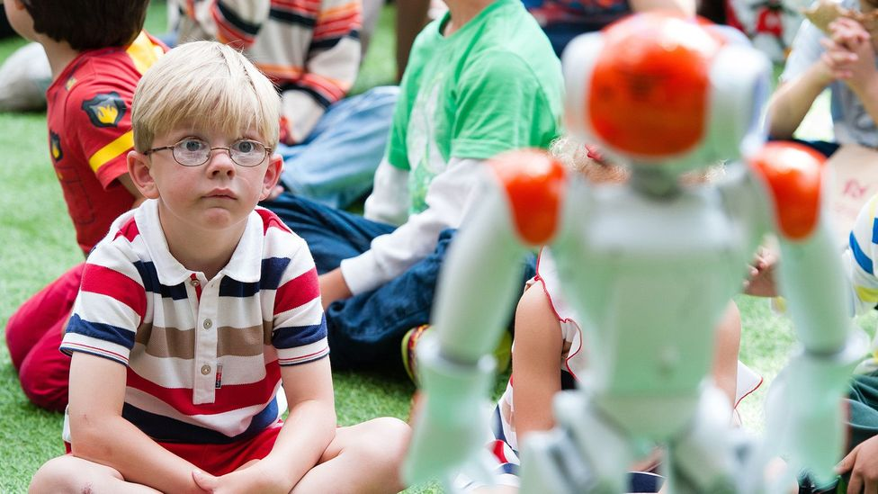 This jovial robot tells stories, sings and dances for children – but could it ever replace a human playmate? (Credit: Getty Images)