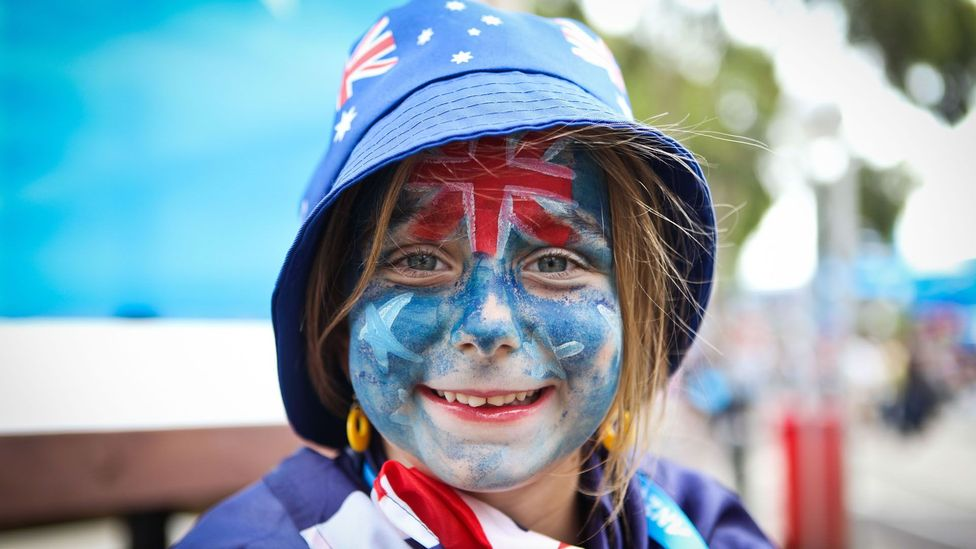 girl with face painted as Australian flag