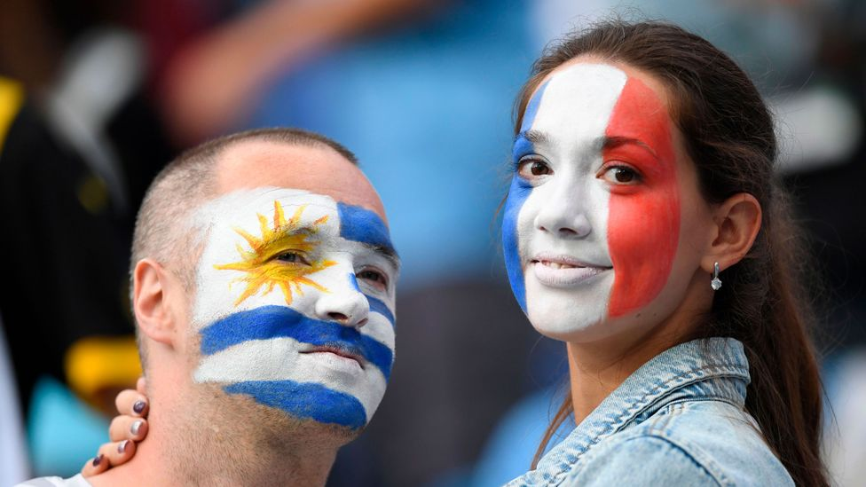 man and woman with flags painted on face