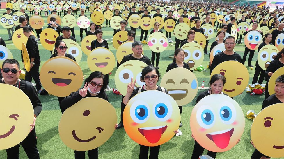 In May, 932 people in Fuyang, China gathered to set the Guinness World Record for most people dressed up as emoji faces (Credit: Getty Images)