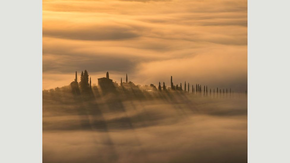 """""""The view is looking across the Val d'Orcia from just below Castiglione d'Orcia in Tuscany. There is often low-lying mist as the sun rises"""" – Phil Malpas (Credit: Phil Malpas)"""