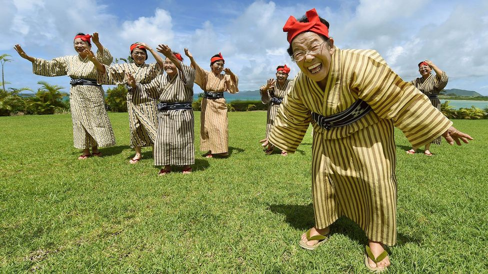 These elderly singers from Okinawa are members of Japanese 'girl band' KBG84, with an average age of 84 (Credit: Getty Images)