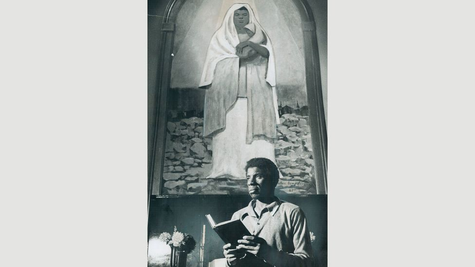 A black Madonna is shown behind Beverly Williamson, caretaker of the Central United Church of Christ in Detroit (Credit: Getty Images)