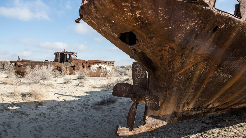 Rusting ships sit in the desert in the former port in Moynaq, Uzbekistan (Credit: Taylor Weidman)