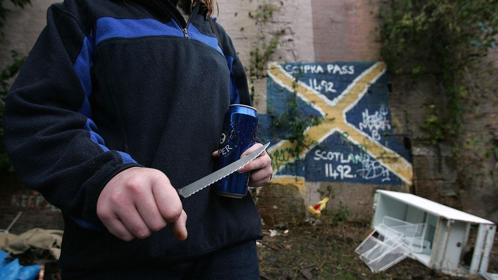 A woman shows the knife she carries with her in Glasgow in 2005, the year the city was named Europe's most violent (Credit: Getty Images)