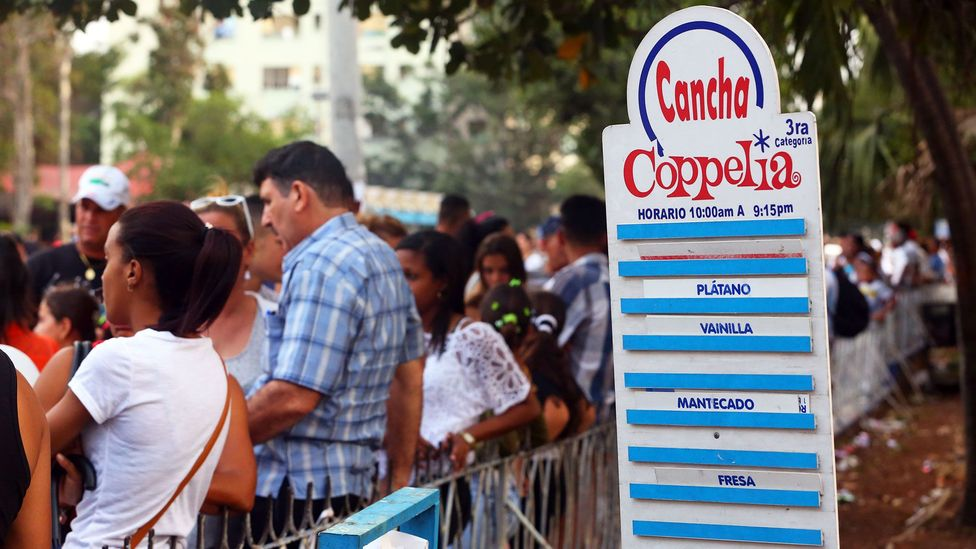 On hot days, residents of Havana wait an hour or more for a bowl of ice cream at Parque Coppelia (Credit: Christopher P Baker)