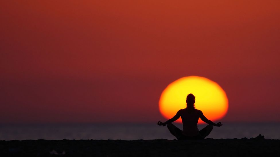 Some of the world's biggest companies have embraced minfulness, using meditation programmes as a way of tackling stress, staff turnover and absenteeism (Credit: Getty Images)