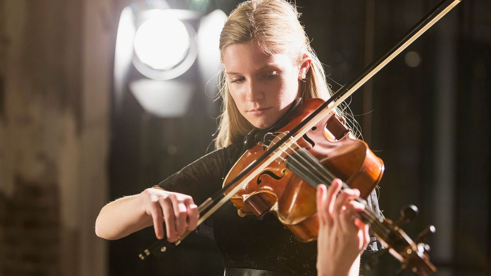 One study of symphony musicians found that blind auditions – where screens concealed a musician's gender – increased women's chances by 50% (Credit: Getty Images)