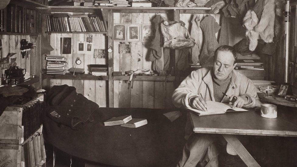Robert Falcon Scott writing his journal (Credit: Herbert Ponting/Wikipedia)