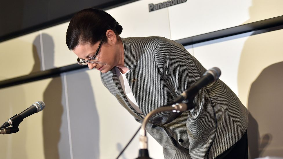 McDonald's Japan president Sarah Casanova bows her head in apology as she announces the company's restructuring plan at the Tokyo Stock Exchange  (Credit: Getty Images)