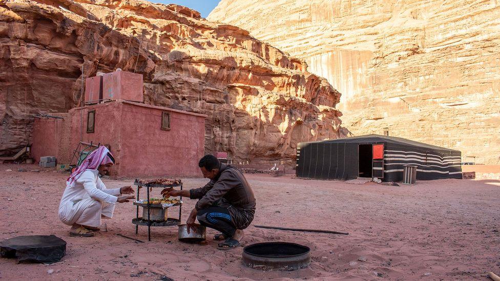 Back at camp, Abu Rashid and the cook, Muhammed, readied zarb for dinner (Credit: Amanda Ruggeri)