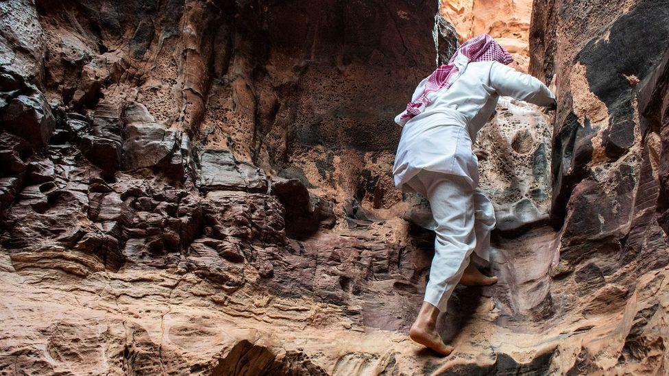 One of Abu Rashid's skills: scrambling up canyon walls with ease (Credit: Amanda Ruggeri)