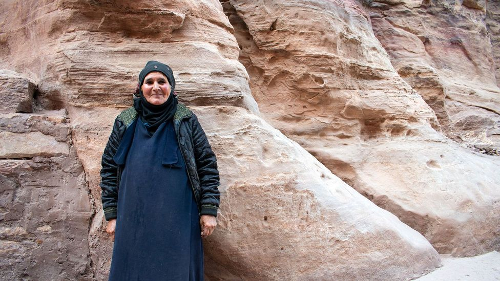 Bedouin across Jordan, like this woman in Petra, have found their way of life change over the last few decades (Credit: Amanda Ruggeri)